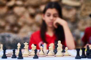 woman playing chess