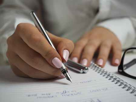 person hands woman pen